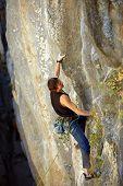 picture of climbing wall  - rock climber climbs on a rocky wall - JPG