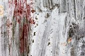 foto of nail paint  - Abstract background gloomy concrete wall casually painted dark paint weathered with cracks and scratches in the wall hammered a rusty nail - JPG