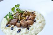 picture of giblets  - Pork kidneys risotto and parsley on a plate - JPG