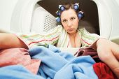 picture of tramp  -  a woman reaching in the dryer for clothes  - JPG