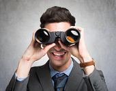 foto of binoculars  - Businessman watching through binoculars in search of new opportunities - JPG