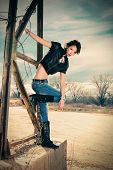stock photo of rebel  - young rebel woman in blue jeans - JPG