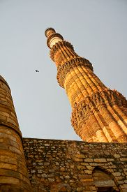 stock photo of qutub minar  - Famous Qutub minar shot from a very low angle - JPG