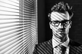 image of posh  - Posh businessman in eyeglasses looking at camera - JPG