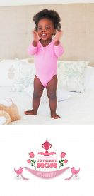 pic of babygro  - mothers day greeting against baby girl in pink babygro standing on bed - JPG