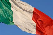 stock photo of italian flag  - italian flag blowing in the wind against clear blue sky - JPG