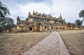 image of nu  - Maha Aung Mye Bon Zan Monastery well known as Me Nu Oak Kyaung or the Brick Monastery was built by Nanmadaw Me Nu Chief Queen of King Bagyidaw in 1818 in Inwa ancient cityMandalay StateMyanmar - JPG