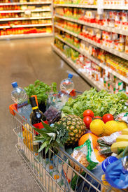 foto of grocery cart  - Inkaufswagen in full with fruit vegetable food supermarket - JPG
