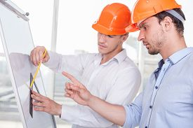 stock photo of finger  - Attractive architects are working on a project - JPG