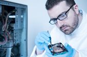 Lab Engineer Working On Broken Hard Disk poster