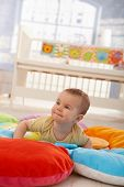 image of playmate  - Happy cute infant lying on playmat - JPG