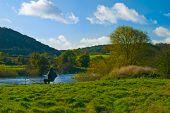 Fisherman at the river Severn, Shropshire, UK