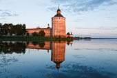 Tower Of A Monastery On A Sunset