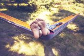Kid Is Relaxing And Swinging In A Hammock poster