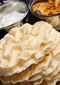 Indian poppadums with raita and mango chutney.