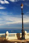 stock photo of algiers  - Street lamp in front of the sea - JPG