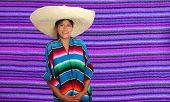 Latin mexican hispanic sombrero poncho woman over serape purple background