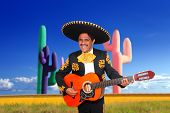 Mexican mariachi charro singing playing guitar in cactus background Mexico