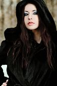 stock photo of close-up shot  - Shot of a gothic woman in a winter park - JPG