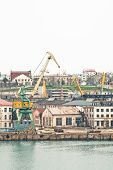 foto of shipbuilding  - Powerful shipbuilding shipyard with a pier and cranes - JPG