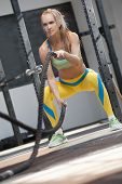 Battle Ropes Workout. Portrait Of Sporty Athletic Girl During High Intensive Cardio Or Cross Power T poster