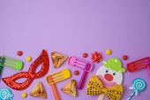 Jewish Holiday Purim Background With Cute Paper Clowns Character, Hamantaschen Cookies And Carnival  poster