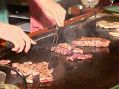 Tap Pan Yaki Chef in action at an upscale Japanese restaurant .