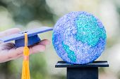 Study Abroad International Graduated Ideas. Education World Or Graduation Hat On Hands With Paper Ma poster
