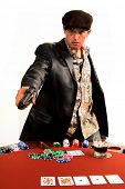 Mexican man playing Texas Hold um Poker draws a pistol as the game goes bad