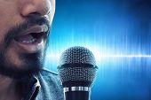 Close Up Male Singer Singing With Microphone poster