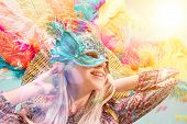 Beautiful Young Woman In Carnival Mask. Beauty Model Woman Wearing Masquerade Mask At Party Over Hol poster