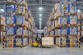 Forklift truck in warehouse or storage and shelves with cardboard boxes. 3d illustration poster