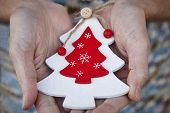Handcrafted Wooden Christmas Tree. Love And Tenderness Between Elderly People. poster