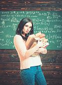 Brunette Female Student In Classroom. Sexy Young College Girl Walking With Two Heaps Of Books. Value poster