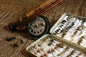 stock photo of fly rod  - Some vintage fly fishing flies, rod and reel