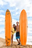 Beach surf fun. Happy surfers young tourists people posing with long orange surfboards in Hawaii bea poster