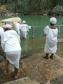 Visitors/Tourists/ Religious People Baptizing In Jordan River In The Holy Land/ Israel.