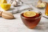 Cup Of Hot Tea With Lemon On Wooden Table, Space For Text. Cough Remedy poster