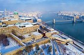 Budapest in winter. Hungary - skyline panorama of Budapest in the winter. The Danube the Parliament  poster