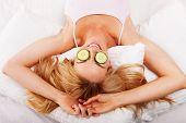 Woman Using Cucumber Eyepads