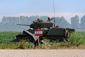 stock photo of landmines  - World War II era tank behind land mine sign - JPG