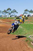Motocross Rider Jumping Into Corner