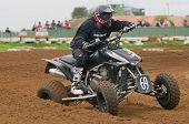Atv Motocross Rider Powering Out Of Corner