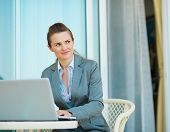 Thoughtful Business Woman Working On Laptop