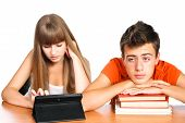 Two Students Learning With Books And Pad: Concept New Educational Technology