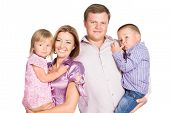 Young Happy Parents Holding Two Kids 3-4 Years Old On Their Hands Isolated Over White