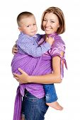 Happy Mother Carrying A Sad Boy 3-4 Years Old In Sling Isolated On White Background