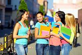 Four Beautiful College Girls Talking On The Street
