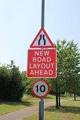 Road narrows and new road layout signs