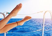 Closeup on beautiful sexy women's feet on the yacht, carefree vacation, journey on sailboat, happy a